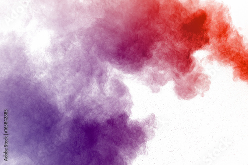 Abstract art powder paint on white background. Movement abstract frozen dust explosion multicolored on white background. Stop the movement of colored powder on white background. - 165842885