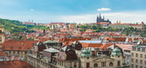 Prague view from above in  daytime with cloudy blue sky