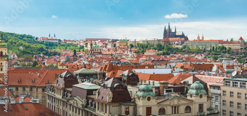 Tuinposter Praag Prague view from above in daytime with cloudy blue sky