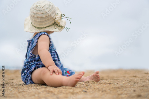 asian baby on the beach Poster