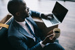 african american businessman working with laptop during coffee break in cafe