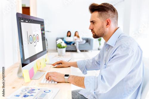 Hipster man designing a logo Poster