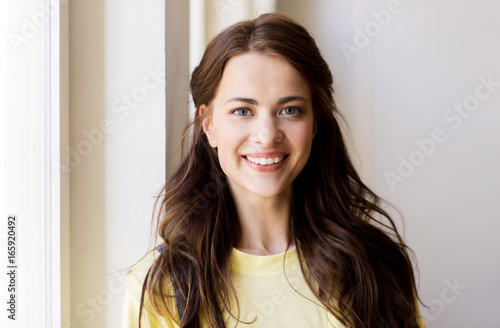 portrait of smiling young woman or teenage girl