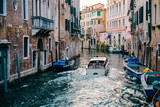 Private boat on a canal in Venice.