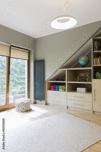 Spacious kids' room with balcony - 165938601