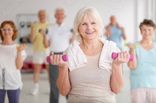 Elders with dumbbells