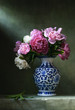 Still life with pink peonies in a chinese vase