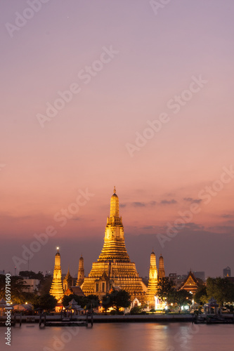 Wat Arun, located along the Chao Phraya River in Bangkok at sunset.