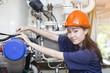 young woman engineer setup and testing machine