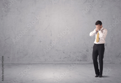 Young businessman standing confused - 165992644