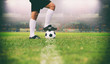 soccer or football player standing with ball on the field for Kick the soccer ball