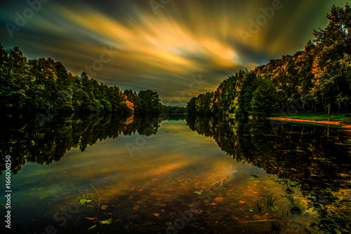 Long exposure sunset in autumn Poster