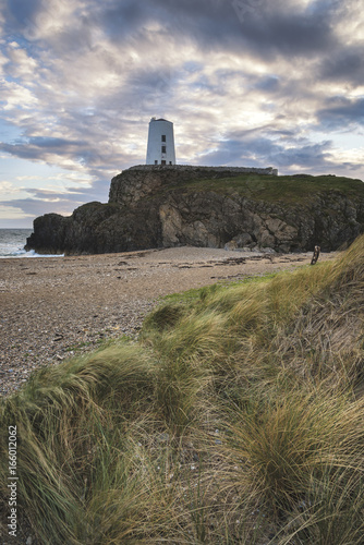 Stunning Summer landscape image of lighthouse on end of headland with beautiful Poster