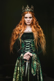 Woman in green medieval dress - 166019407