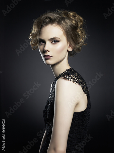 Beautiful young lady on black background