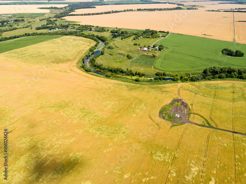 Top view of grain fields with electrical substation, Russia