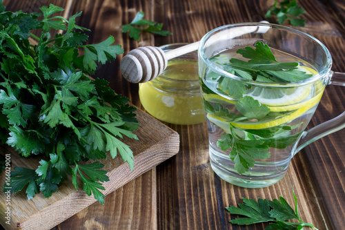 Tea with parsley,honey and lemon on the wooden background Poster