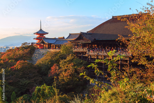 Kiyomizu-dera temple at sunset against blue sky background, Kyoto, Japan