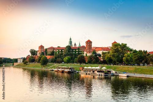 Krakow. Poland. Wawel on the river. Castle, the cathedral and the tomb of Polish kings. Summer. Sunset.