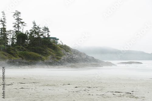 House on the cliff above beach in fog - 166046224