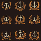 Set of the emblems with anchors and wreaths in golden style. Design elements for logo, label, emblem, sign, badge. Vector illustration