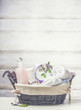 canvas print picture - Basket with spa ,wellness or beauty setting on white wooden background, front view