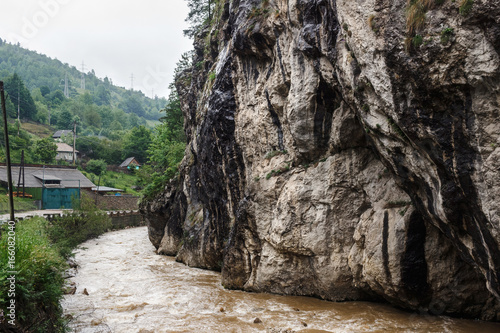 Wild nature landscape, scenery of Bicaz river flow and cliff in Carpathian mountains, Romania