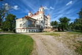 Neo-Gothic style palace surrounded by an English landscape garden in Wojanow, Poland - 166093030