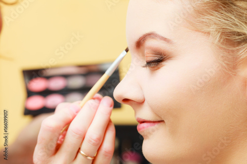 Close up woman getting make up, eyebrows Poster