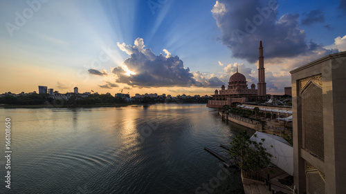 scenery of sunset with beautiful and stunning sun ray in the cloud at Putra Mosque, Putrajaya