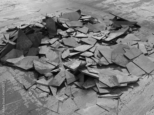 Dark concrete destruction surface with many chaotic broken pieces