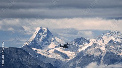 swiss army helicopter in front of the Matterhorn