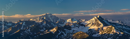 Tuinposter Ochtendgloren First rays of raising sun on mountain peak. Mounts Zakzan-Syrt and Pshish. Caucasus Mountains.