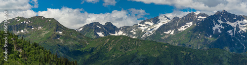 Foto op Canvas Nachtblauw Tops of mountains range with snow caps. Greater Caucasus Mountain Range.
