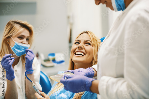 Woman in Dentist Office - 166138062