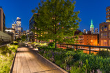 High Line promenade at twilight with city lights and illuminated skyscrapers. Chelsea, Manhattan, New York City - 166140056