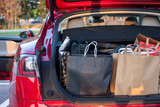 shopping bags in car - 166152860