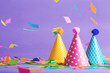 Party hat celebration theme with confetti on a bright background