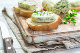 Sandwiches with herbs butter On Cutting board on white wooden background - 166166006