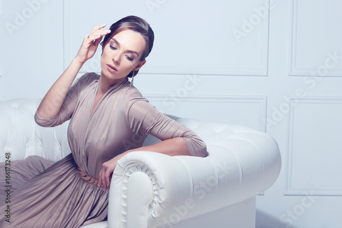 Plakát Fashion portrait of beautiful lady in gold evening dress