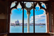 Spectacular view of Venice from a typical Venetian window. The city is preparing for Redentore. Bell tower of Saint Mark, basilica and Giudecca canal are the main subjects