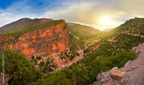 Spoed canvasdoek 2cm dik Marokko look on bright, saturated color of the mountain of the Atlas on a sunset in Morocco, on a slope of mountains winds the road
