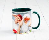 Big green cup with dark green handle and print of a kids cooking something - 166196454