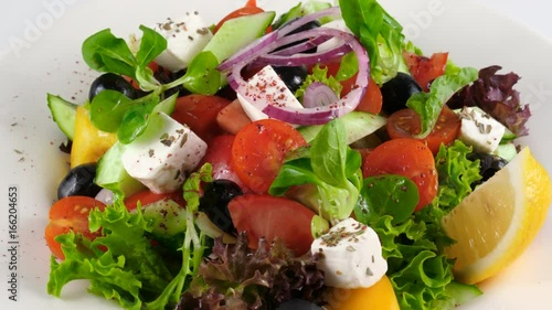 Tasty low fat organic Greek salad with feta cheese and vegetables, loop, 4K, ProRes codec, 422 HQ, ISO 100