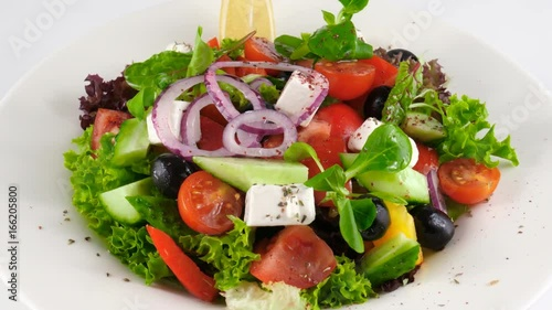 Restaurant Greek salad with feta cheese and tomatoes, olives, cucumbers, onion, red pepper, loop, 4K, ProRes codec, 422 HQ, ISO 100