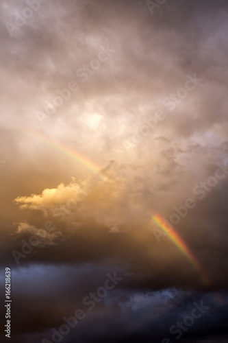 Rainbow forms among dramatic clouds, Taliouine, Morocco