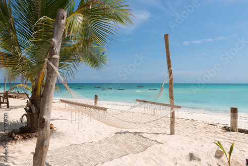 Deurstickers Zanzibar white handmade hammock with palm tree on Zanzibar beach