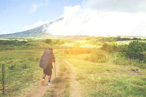 Staande foto Meloen Asian traveling backpacker in volcano mountain Rinjani of Indonesia.