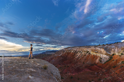 Woman standing at the edge of a big canyon in the southwest