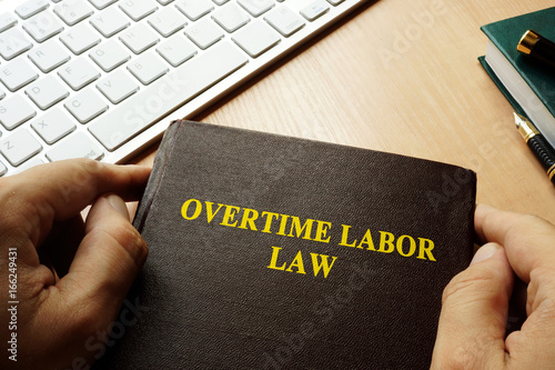 Book with title overtime labor law. Poster